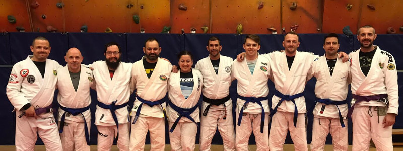 Robin French wIth Professor Allan Manganello, Peter Squire, and New TPSUK Blue Belts - Nov 2019